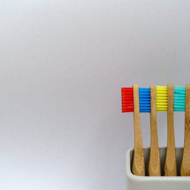 A group of pencils in a cup Description automatically generated with medium confidence